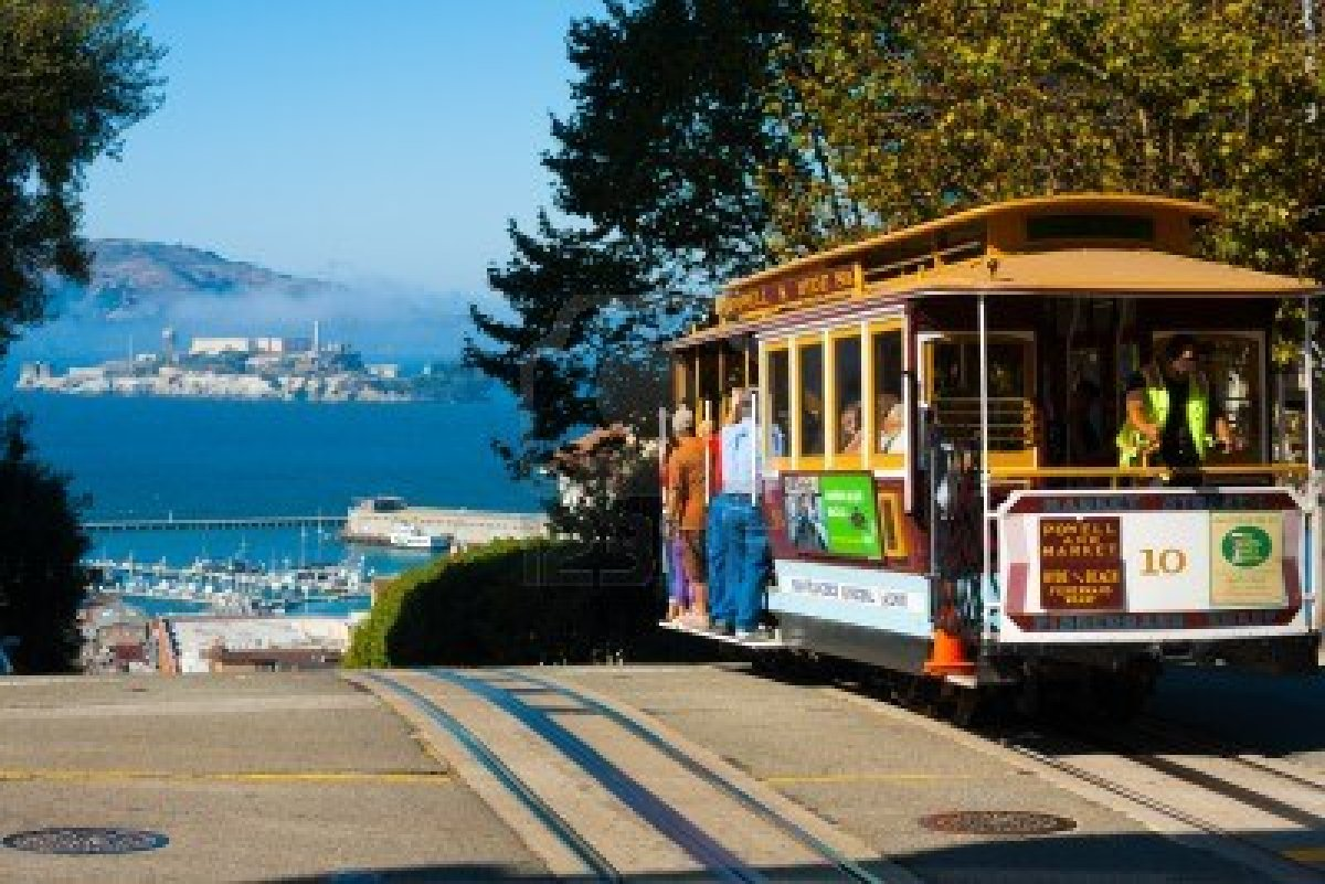 14681941-san-francisco-usa--september-21-2011-powell-hyde-cable-car-an-iconic-tourist-attraction-descends-a-s.jpg