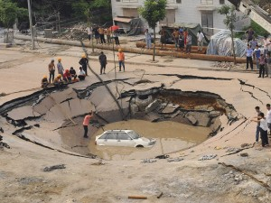 Car in Sinkhole.  Photography used by Fasnacht.