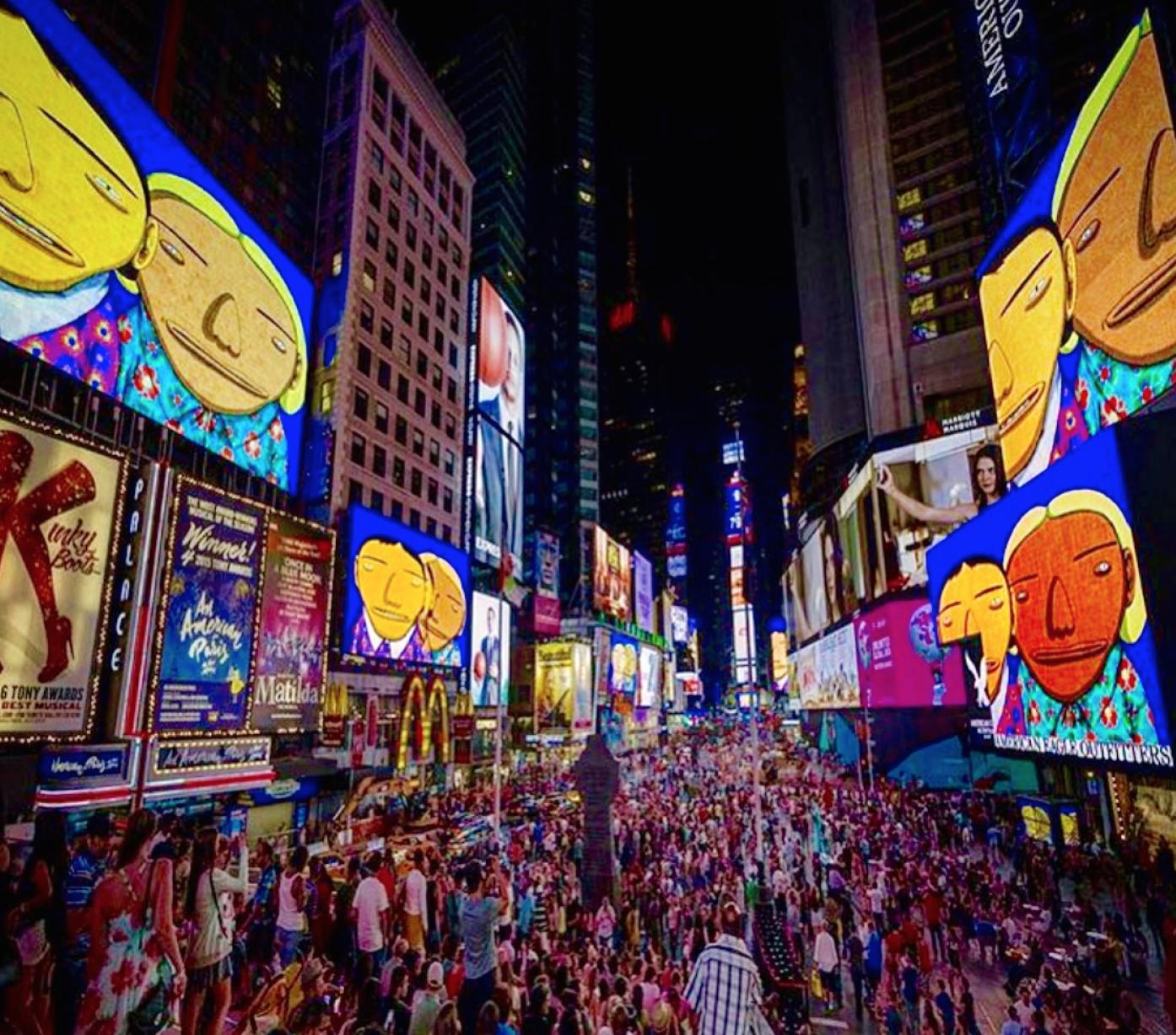 Os Gemeos (aka: Gustavo & Otávio Pandolfo) in Times Square