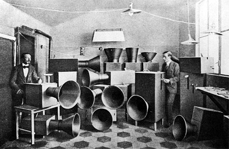 Luigi Russolo and assistant with Intonarumori (noise-making machines), 1913.
