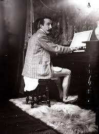 Gaugiom playing the harmonium in Alphonse Mucha's studio. 1895. Paris.