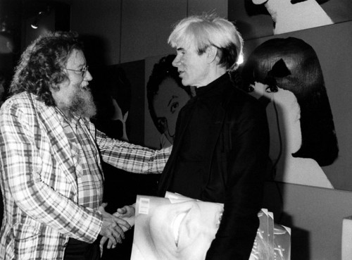 Pierre Restany shaking hands with Andy Warhol