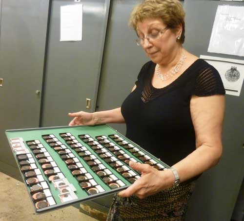 Elena Stolyarik, collections manager of the American Numismatic Society, with a tray of coins reclaimed from the Hispanic Society of America's disposalPhoto by Lee Rosenbaum