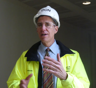 Don Bacigalupi taking reporters on a hardhat tour of the in-construction Crystal Bridges Museum, May 2011