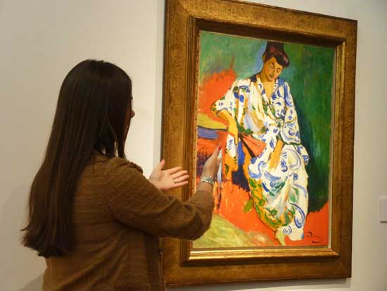 "Brooke Lampley extolling virtues of Derain's ""Madame Matisse"" at Christie's press preview Photo by Lee Rosenbaum"