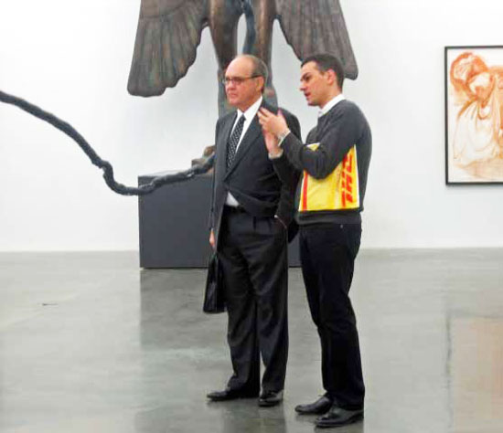 Massimiliano Gioni (right) discussing Dakis Joannou show with a visitor at the New Museum Photo by Lee Rosenbaum
