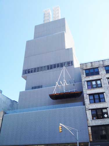 "Chris Burden's ""Ghost Ship,"" 2005, and ""Twin Quasi Legal Skyscrapers,"" 2013, on the façade and roof of the New Museum Photo by Lee Rosenbaum"