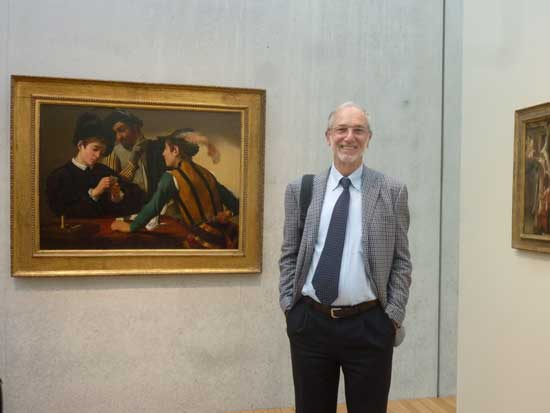"Architect Renzo Piano in front of Kimbell Art Museum's signature Caravaggio, ""The Cardsharps,"" installed on concrete wall in the new Piano Pavilion Photo by Lee Rosenbaum"