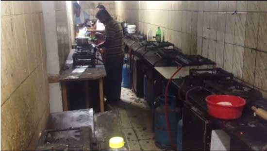Kitchen in a workers' camp on Saadiyat Island Screenshot from video by the Guardian