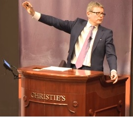 Auctioneer Jussi Pylkkänen at last night's Christie's blowout