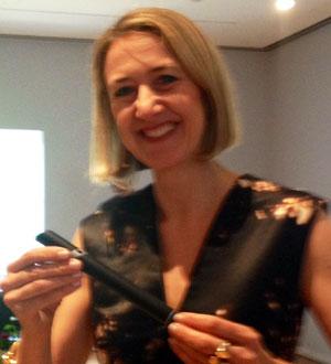 """Caroline Baumann, Cooper Hewitt director, holding the """"Interactive Pen"""" Photo by Lee Rosenbaum"""