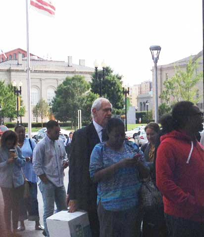 Charles Patrizia (holding white file box), waiting to go through metal detectors at D.C. Superior Court Photo by Lee Rosenbaum