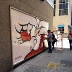 Workers affixing image of LIchtenstein's TK to exterior of Sotheby's Photo by Lee Rosenbaum