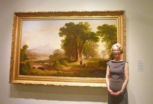"Carmine Branagan, director of the National Academy, posing in 2011 in front of Asher B. Durand's ""The Morning of Life,"" 1840 Photo by Lee Rosenbaum"