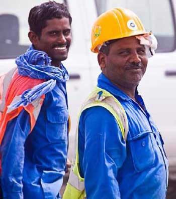 Photo of happy workers from TDIC's latest Employment Practices Policy Compliance Monitoring Report