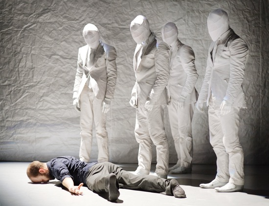 "Prospero (Eric Beauchesne) regarded by some of the ""replicas""  at the end of Kidd Pivot's The Tempest Replica by Crystal Pite. Photo: Geörg Baumann"