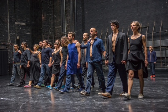 Members of Rosas and graindelavoix walk together in Anne Teresa De Keersmaeker's Cesena. Photo: Stephanie Berger