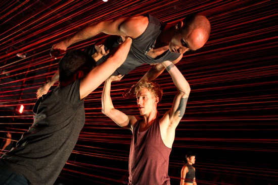 Jeff Sykes (L) and Bryan Strimpel lift Matthew Albert in Brian Brooks's Run Don't Run. Photo: Julieta Cervantes