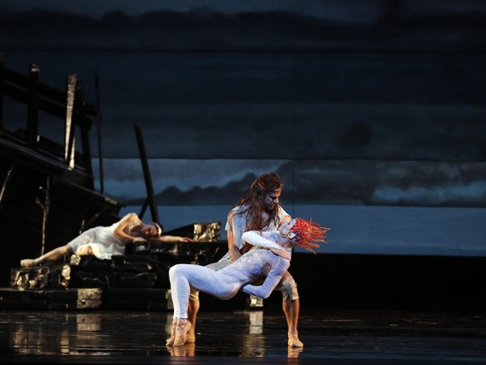 Prospero deals with Ariel. Miranda sleeps. The first-night cast of Alexei Ratmansky's The Tempest: Marcelo Gomes holding Danil Simkin, Sarah Lane at back. Photo: Marty Sohl