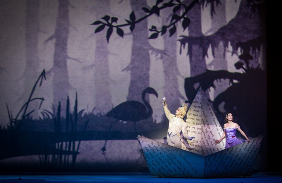 "As in The Sleeping Beauty, Alice  (Jillian Vanstone) and the White Rabbit (Dylan Tedaldi) ""travel"" through a moving panorama. Photo: Yi-Chun Wu"