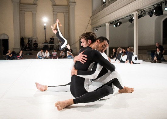 Moriah Evans's Social Dance 9-12: Encounter. Foreground: Rashaun Mitchell and Benny Olk. Jumping: Maggie Cloud. Seated (L to R): Lizzie Feidelson and Lydia Okrent. Photo: Ian Douglas
