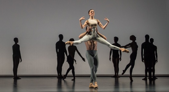 Anna Nowak lifted by James Pett in Wayne McGregor's Outlier. Photo: Kevin Yatarola
