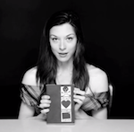 Stoya shows the cover of Necrophilia Variations.