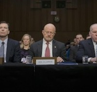 The lineup: U.S. intelligence officials testified yesterday in an annual hearing before the Senate Intelligence Committee. Clapper is the center figure. [Photo: Pablo Martinez Monsivais/AP]