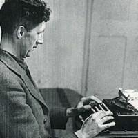 George Orwell at his portable manual Remington typewriter.