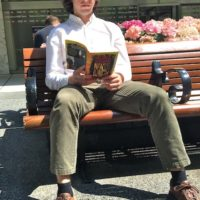 Civilian reading 'Naked Lunch' in midtown Manhattan.