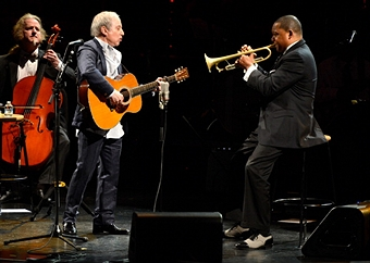 from left: Mark Stewart, Paul Simon, Wynton Marsalis (photo by Kevin Mazur)
