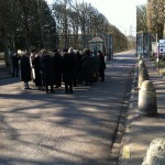 The patrons of Op. Lafayette walk to into the closed gardens of Versailles