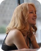 Maria Schneider facing right
