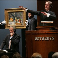Who bears the burden of auction house fees, buyers or sellers?
